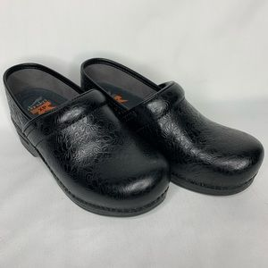 Dansko XP black floral embossed clogs/mules